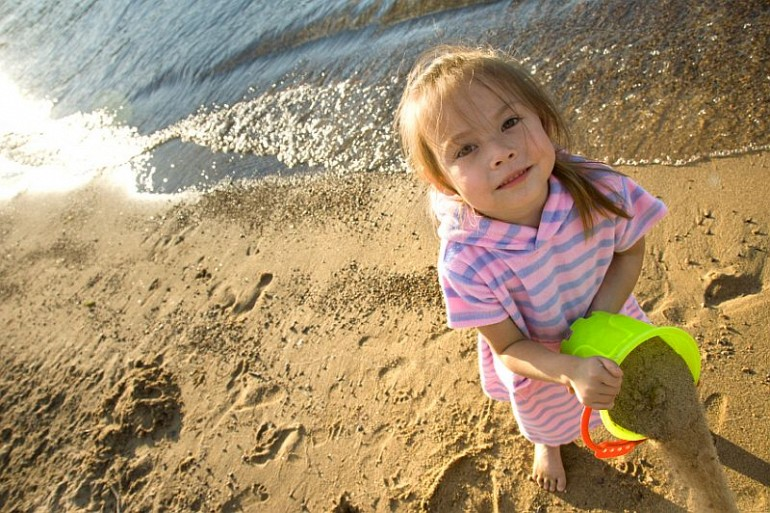 51_6 little girl on beach with bucket resized Beach Fun Gallery Image