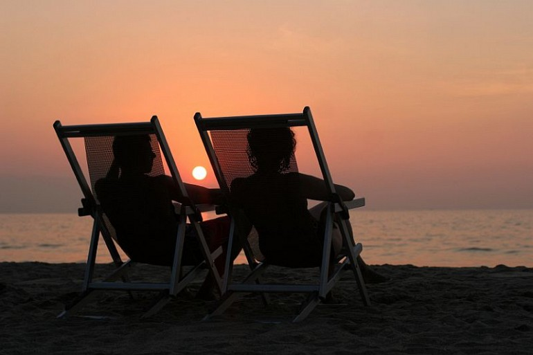 52_9 sunset beach couple chairs resized Beach Fun Gallery Image
